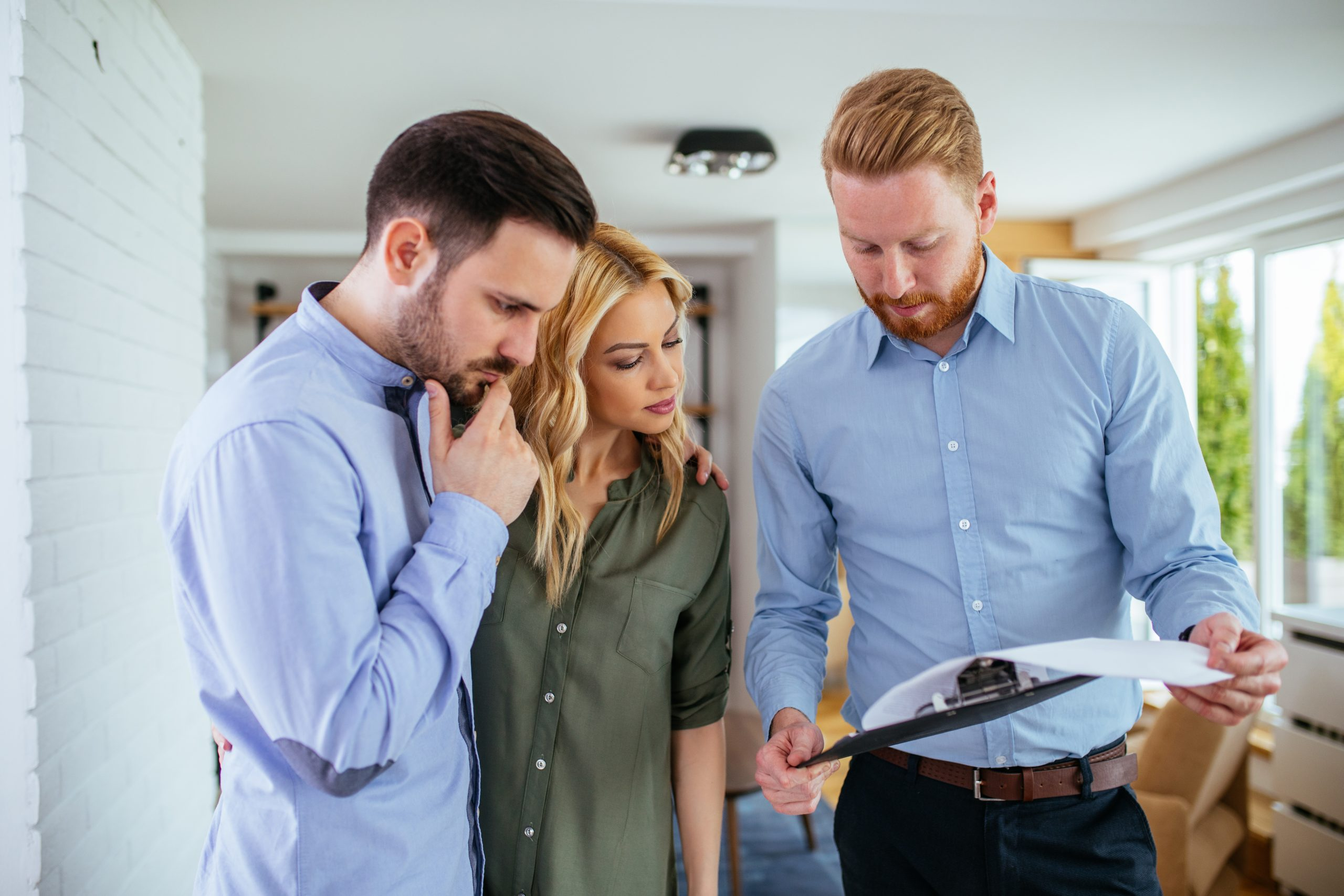 investment property owners inspecting contract