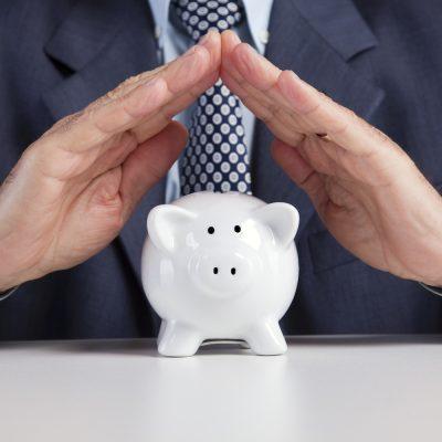 Senior hands saving some money for retirement (isolated on black)